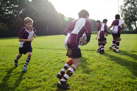 Teenage schoolboy rugby team in practice