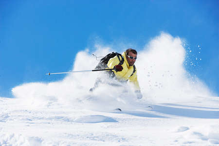 gifted: Male skier speeding down mountain