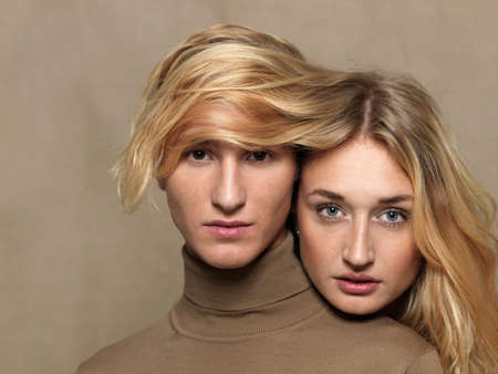 resourceful: Young woman covering mans head with long blonde hair
