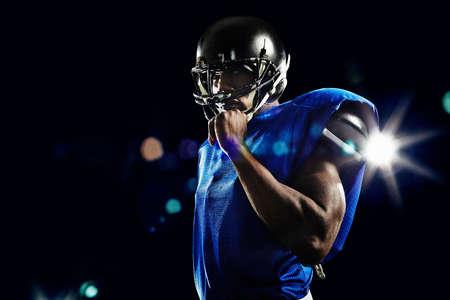 low self esteem: Portrait of american football player wearing helmet