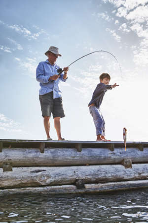Grandfather and grandson fishing,Utvalnas,Sweden