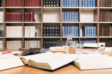 Desk covered with books in law firm