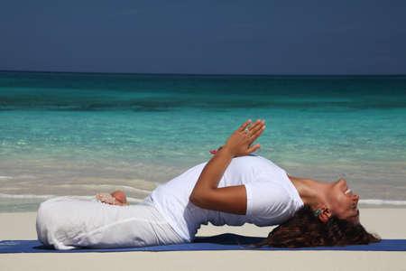Young woman on beach doing yoga,Paradise Island,Nassau,Bahamas
