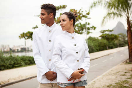 Portrait of young male and female service staff,Rio De Janiero LANG_EVOIMAGES