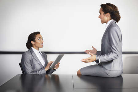 manipulated : alter: Businesswomen in office,multiple image