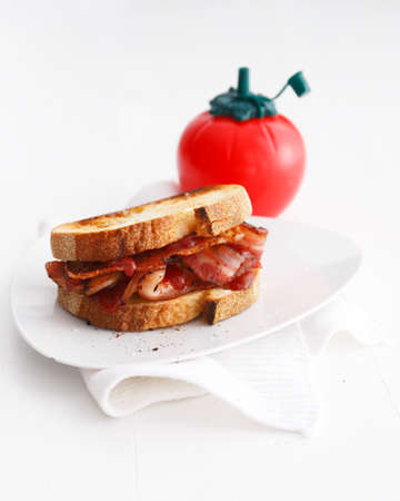 Bacon sandwich with tomato ketchup LANG_EVOIMAGES