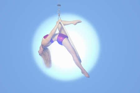 Female dancer balancing on hoop