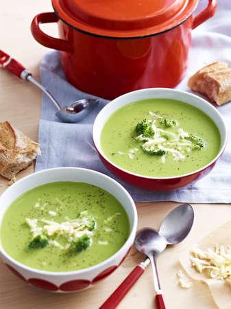 Saucepan and bowls of broccoli soup
