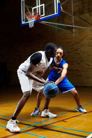 athletic wear: Two young men playing basketball