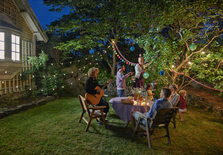 Family group preparing for evening garden party