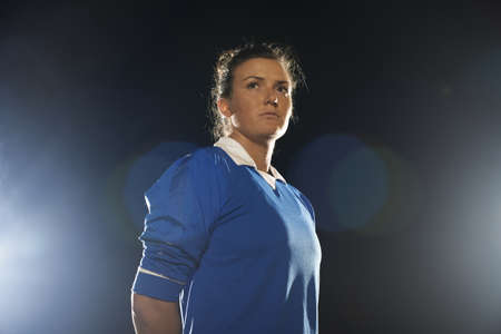low self esteem: Portrait of female soccer player