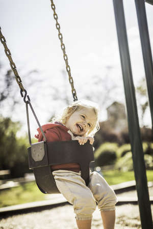Baby girl on swing