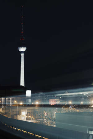 flood area: Moving train and television tower at night,Berlin,Germany