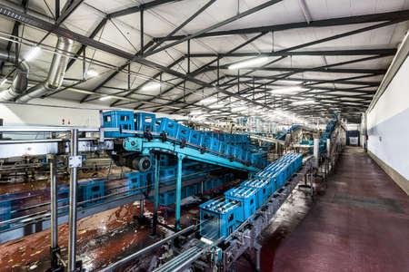 Crates of mineral water on bottling plant conveyor belt