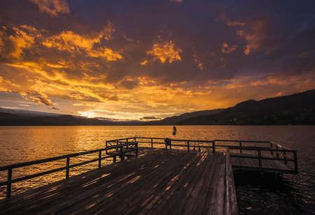 Young woman jumping off Wharf Park into Okanagan Lake in the South Okanagan Valley, Naramata, British Columbia, Canada