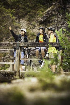 Three mountain bikers taking a break