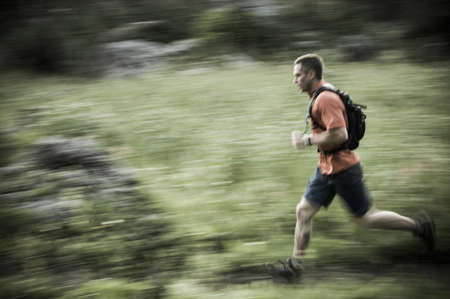 Male trail runner in Albion Basin near Alta Ski Area in Little Cottonwood Canyon, Wasatch Mountains, Utah, USA LANG_EVOIMAGES