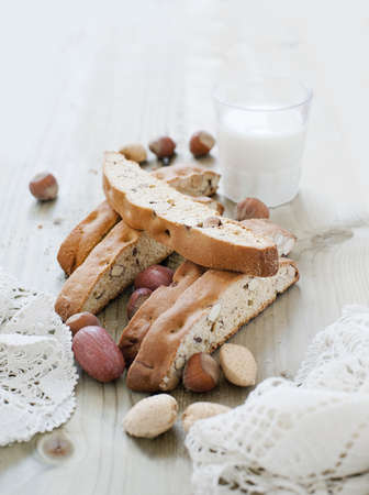 Hazelnut biscotti and a glass of milk LANG_EVOIMAGES