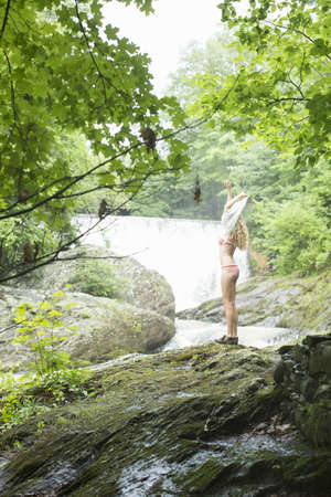 undoing: Teenage girl undressing for swim