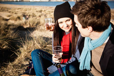 scarves: Couple celebrating with white wine at coast, Bournemouth, Dorset, UK