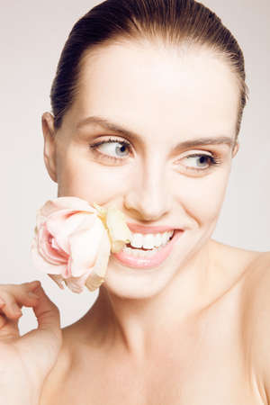 Model biting on rose petal LANG_EVOIMAGES