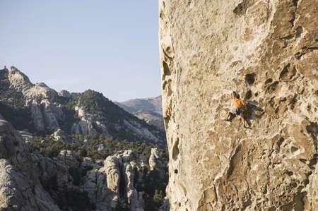 athletic wear: Man climbing  Tribal Boundaries 5.10a - Flaming Rock, City of Rocks, Idaho, USA LANG_EVOIMAGES