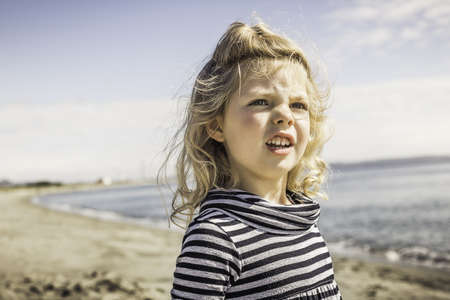 county fair: Girl on beach, Port Townsend, Washington, US
