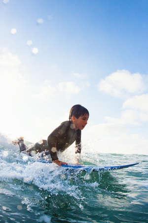 tweens: Young boy practicing on surfboard,Encinitas,California,USA LANG_EVOIMAGES
