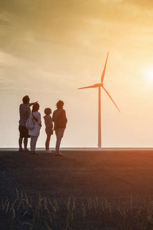 Family group looking at Wind turbines and Eastern Scheldt Storm Surge Barrier, designed to protect the Netherlands from flooding. Neeltje Jans, Netherlands LANG_EVOIMAGES