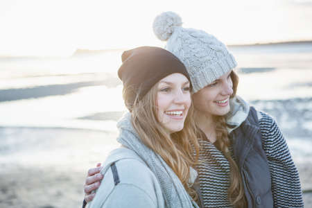 Two female friends enjoying the beach LANG_EVOIMAGES