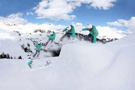 Multi exposure of young woman snowboarding on mountain, Mayrhofen, Tyrol, Austria LANG_EVOIMAGES