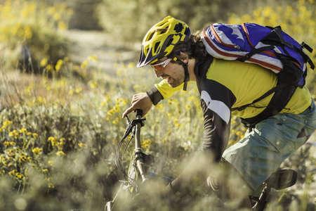 athletic wear: Young man mountain biking, Fontana, California, USA LANG_EVOIMAGES