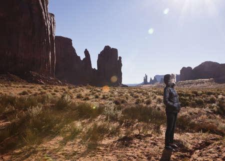 tallness: Female tourist alone in Monument Valley,Navajo Tribal Park,Arizona,USA