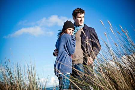 sweatshirts: Couple standing on sand dunes, Bournemouth, Dorset, UK