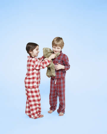 pyjama: Children playing with teddy bear