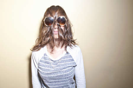 silliness: Woman wearing sunglasses with brown hair covering face