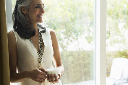 Portrait of mature woman holding coffee cup