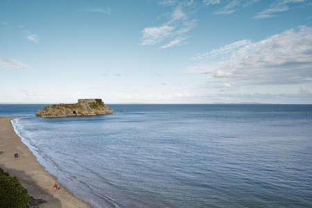 liberating: View of beach and rock formation, Tenby, Wales, UK