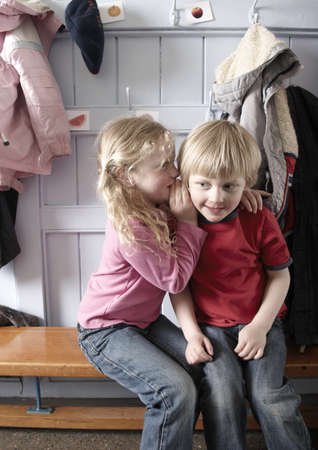 Girl whispering in boys ear