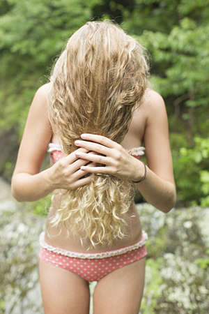 obscuring: Teenage girl with hair covering face LANG_EVOIMAGES