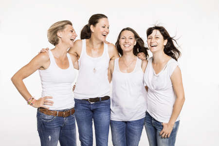 sleeve: Studio portrait of four happy mid adult women