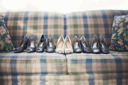 ladys: Row of shoes on sofa