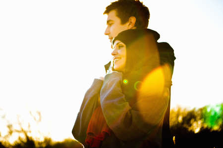 Romantic couple in sunlight LANG_EVOIMAGES