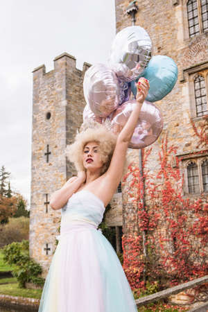 ceremonial make up: Bride outside castle, holding balloons