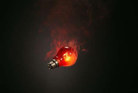 environmental issues: Still life of red smoking illuminated lightbulb