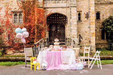Table and balloons, outside castle