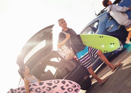 Family carrying surfboards,Encinitas,California,USA