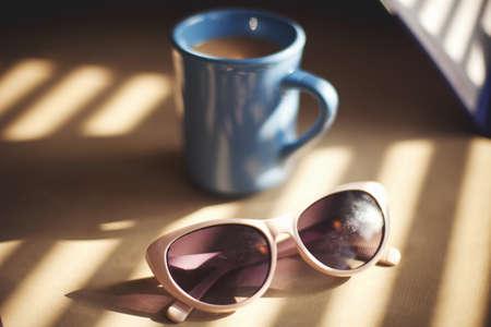 vintage: Sunglasses and mug of coffee