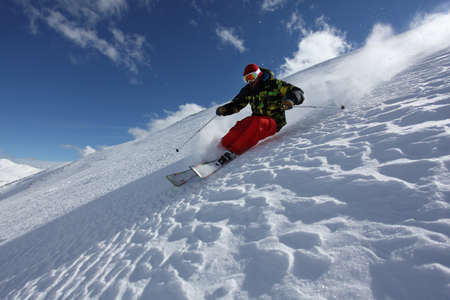 Mid adult man skiing down steep slope, Mayrhofen, Tyrol, Austria