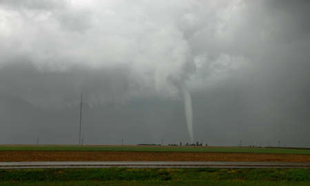 narrowly: An elephant trunk tornado narrowly misses a homestead, Granfield, Kansas, USA LANG_EVOIMAGES